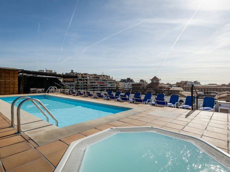 Terrace with outdoor pool, jacuzzi and solarium area sunotel junior  barcelona